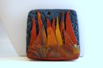 Another polymer clay pin with vivid color, representative of the mountains at sunrise.