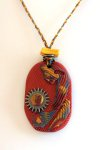 Polymer clay pendant features bright colors and texture - lots of different elements in this one.
